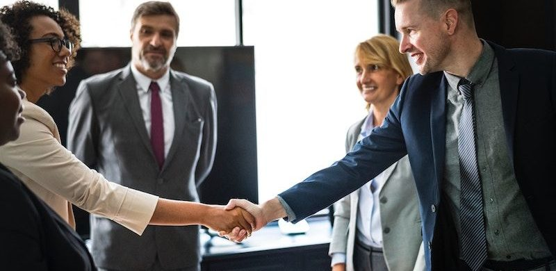 handshake at work, increasing your life insurance coverage after a raise