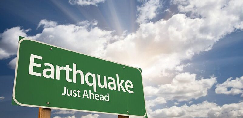 "sign that reads ""earthquake ahead,"" protect home from flood and earthquake"